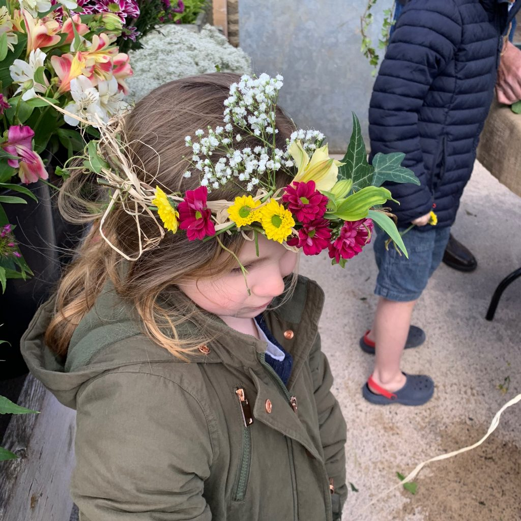 Wearing our floral crowns at Hauser and Wirth, Somerset