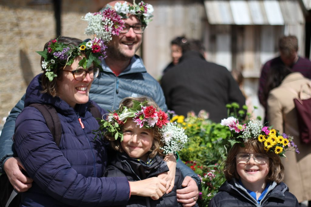 Families enjoy making floral crowns, ahead of Garden Day 2019