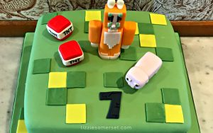 Minecraft themed party - green minecraft cake with Stamy Cat figure